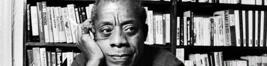 James Baldwin in a library